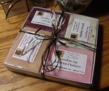 4 individually wrapped Cocoabutter soaps, 5 oz. in a gift box